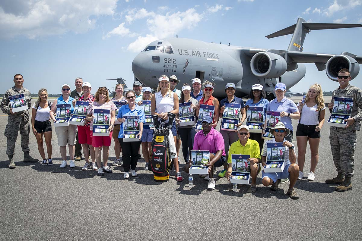 Lexi Thompson with Joint Base in Charleston female servicemembers at golf clinic held on Maay 17, 2019