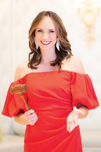 Erin Kienzle adds Auctioneer to Her Many Titles: Going, Going, Gone!