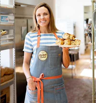 Callie's Hot Little Biscuits founder Carrie Morey  with her famous biscuits.
