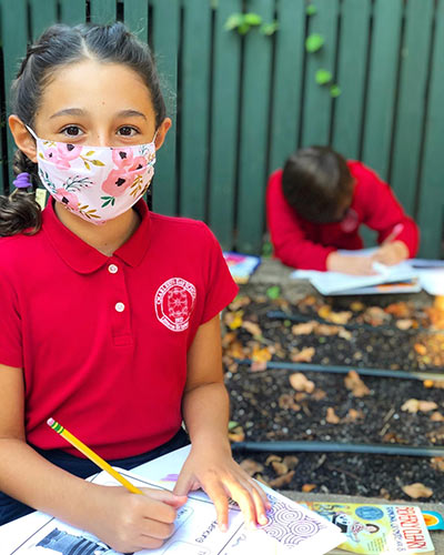 Charleston Day School students do schoolwork with masks so commonly seen during COVID-19.