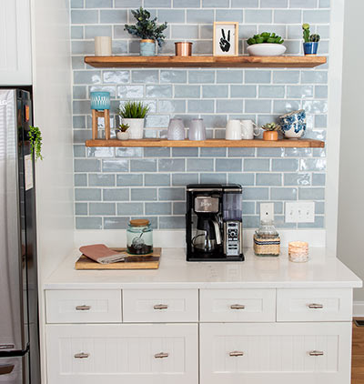 A coffee nook with a beautiful backsplash will help start your morning off right.