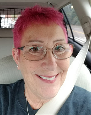 Emily Cravedi dyes her hair pink for Breast Cancer Awareness Month.