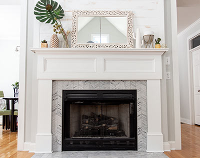 Update your fireplace with a unique mosaic backsplash, like this herringbone.