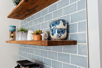 The beauty is in the details. This shelf holds small bowls, some cups and even a couple of plants.