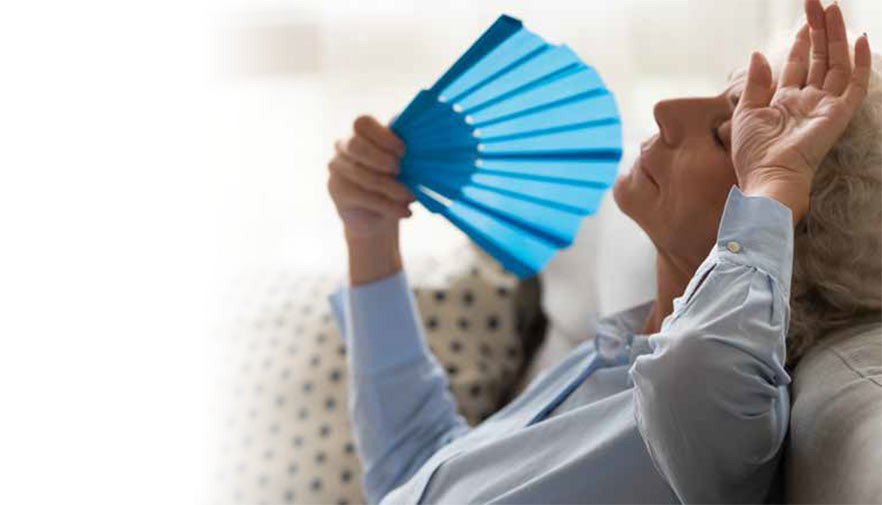 A woman with hot flashes cooling off